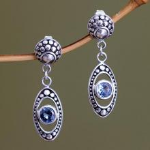 Blue Topaz and Sterling Silver Dangle Earrings, 'Reflections in Blue'