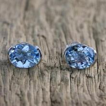 Rhodium Plated Blue Topaz Stud Earrings