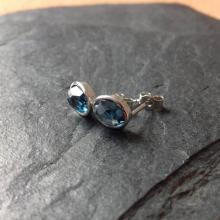 Rose cut gemstone stud earrings in silver with london blue topaz